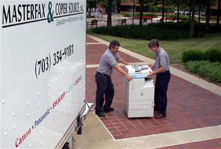 Photo of two technicians delivering equipment